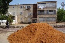 mound of sandy soil ready for compost and planting