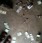 money and candy payments on the garage floor